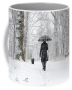 Woman Walking In A Snowy Forest Coffee Mug