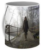 Woman Walking With Her Dog On A Bridge Coffee Mug