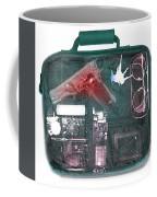 X-ray Of A Briefcase With A Gun Coffee Mug
