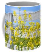 Yellow Flowers And A White Fence Coffee Mug