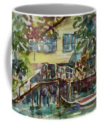 Yellow House By The River Coffee Mug