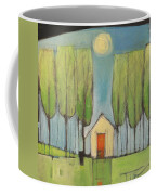 Yellow House In Woods Coffee Mug