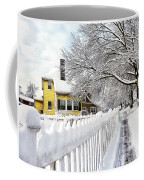Yellow House With Snow Covered Picket Fence Coffee Mug
