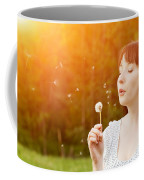 Young Beautiful Woman Blowing A Dandelion In Spring Scenery Coffee Mug