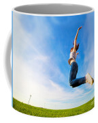 Young Beautiful Woman Jumping For Joy Coffee Mug