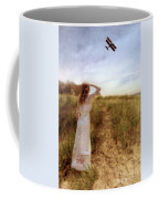 Young Lady In Vintage Clothing Watching A Biplane Coffee Mug