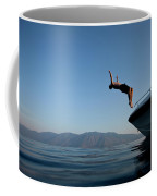 Young Man Flips Off A Boat At Sunset Coffee Mug