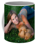 Young Woman And Golden Retriever Puppies Coffee Mug