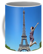 Young Woman Jumping Against Eiffel Tower Coffee Mug