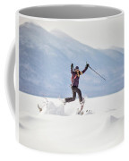 Young Woman Jumping While Snowshoeing Coffee Mug