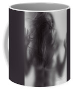 Young Woman Trapped Behind Glass Coffee Mug
