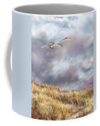 Seagull Flying Over Dunes Coffee Mug