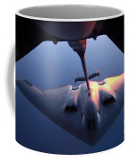A B-2 Spirit Bomber Conducts Coffee Mug by Stocktrek Images
