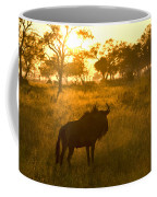 A Backlit Wildebeest Resting Coffee Mug