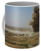 A Cloud Of Dust And Debris Rises Coffee Mug