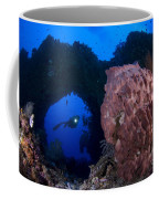 A Diver Looks On At A Giant Barrel Coffee Mug
