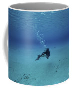 A Diver On A Scooter Explores The Clear Coffee Mug