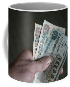 A Hand Holds Egyptian Pounds In Cash Coffee Mug