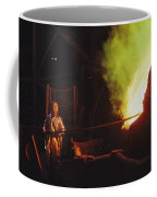 A Man In Protective Gear Tends Coffee Mug