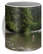 A Man Wades In A River In A Temperate Coffee Mug by Taylor S. Kennedy