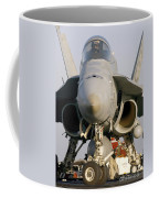 A Pilot Sits In The Cockpit Of An Coffee Mug
