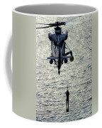 A Search And Rescue Swimmer Is Hoisted Coffee Mug