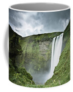 A Waterfall Over A Grassy Cliff Coffee Mug