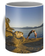 A Woman Does Yoga At Sunset Coffee Mug by Taylor S. Kennedy