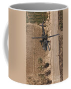 An Ah-64d Apache Helicopter In Flight Coffee Mug