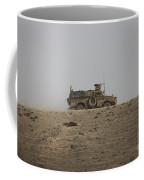 An Mrap Vehicle Patrols The Ridge Coffee Mug