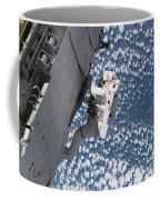 Astronaut Traverses Coffee Mug