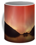 Aurora Borealis Over Jordan Pond Coffee Mug by Michael Melford