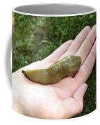 Banana Slug On Hand Coffee Mug