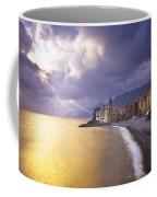 Buildings Along The Coast At Sunset Coffee Mug