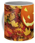 Carved Pumpkin On Fallen Leaves Coffee Mug
