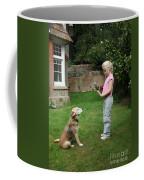 Girl Playing With Dog Coffee Mug by Mark Taylor