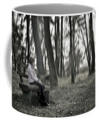 Girl Sitting On A Wooden Bench In The Forest Against The Light Coffee Mug by Joana Kruse