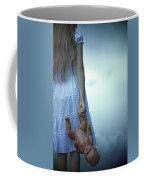 Girl With Baby Doll Coffee Mug by Joana Kruse