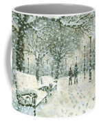Snowing In The Park Coffee Mug