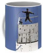 Soldier Rappels Off A Tower While Coffee Mug
