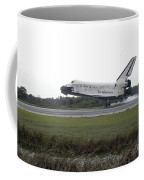 Space Shuttle Discovery Touches Coffee Mug