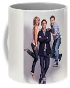 Three Fashionably Dressed Young People Coffee Mug