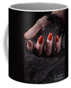 Woman Hand With Red Nails On Black Sand Coffee Mug