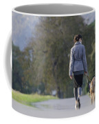 Woman Walking With Her Dogs Coffee Mug
