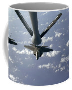 A Three Ship Formation Of F-22 Raptors Coffee Mug by Stocktrek Images