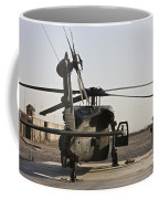 A Uh-60 Black Hawk Helicopter Parked Coffee Mug