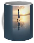 A Woman Enjoys The Warm Sun On The Edge Coffee Mug by Taylor S. Kennedy