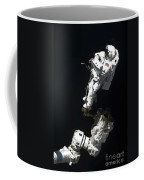 An Astronaut Anchored To A Mobile Foot Coffee Mug
