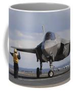 An Aviation Boatswains Mate Directs An Coffee Mug
