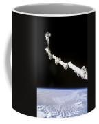 Astronaut Anchored To A Foot Restraint Coffee Mug